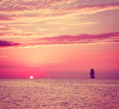 Sailing Ship in Sea at Sunset Stock Photography