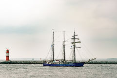 Sailing ship on the sea. Tall Ship and lighthouse Yachting travel. Royalty Free Stock Image