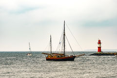 Sailing ship on the sea. Tall Ship and lighthouse Yachting travel. Stock Images