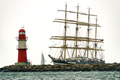 Sailing ship on the sea. Tall Ship and lighthouse Yachting travel. Royalty Free Stock Photography