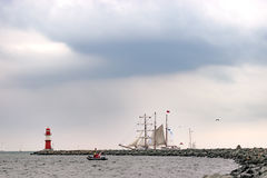 Sailing ship on the sea. Tall Ship and lighthouse Yachting travel. Royalty Free Stock Photos