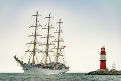 Sailing ship on the sea. Tall Ship and lighthouse Yachting travel. Stock Photo