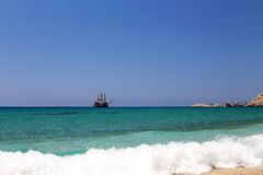 Sailing ship at sea under clear sky Stock Images