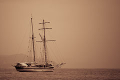 Sailing ship sepia toned. Silhouette of sailing ship in a Ligurian Sea royalty free stock images