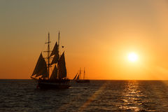 Sailing ship silhouette in sunset on the sea Stock Images