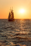 Sailing ship silhouette in sunset on the sea Royalty Free Stock Photos