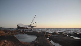 Sailing ship stranded on the rocks stock video footage