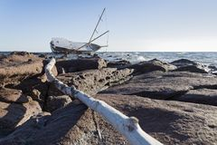 Sailing ship stranded on the rocks Stock Image