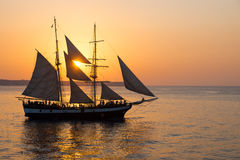 Sailing ship at sunset. A sailing ship and a beautiful sunset royalty free stock images
