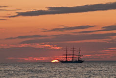 Sailing ship in Sunset. In the Bay of Finland Royalty Free Stock Photography