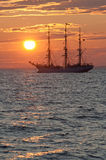 Tall ship in Sunset. Norwegian tall ship Christian Radich in sunset in the Bay of Finland Stock Images