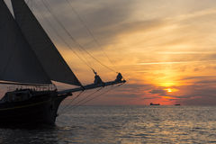 Sailing ship in sunset royalty free stock photo