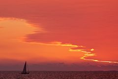 Sailing ship at sunset Stock Images