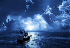 Sailing-ship in time of storm royalty free stock photo