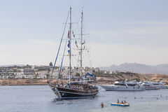 Sailing ship with tourists on board in the bay Stock Photo