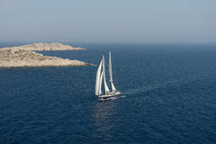 Sailing ship under full sail stock images