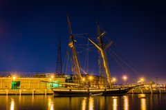 Sailing ship on the waterfront in Fells Point at night, Baltimor Stock Images