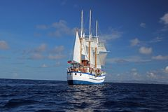Sailing ship in the West Indies. On calm seas with blue skies Royalty Free Stock Photography