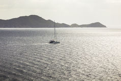 Sailing ship yacht with the island on a background Royalty Free Stock Images