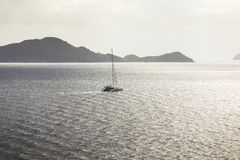 Sailing ship yacht with the island on a background Royalty Free Stock Photo