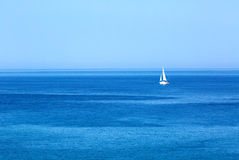 Sailing. Ship yacht with white sails in the open Sea. Luxury boats Stock Photography