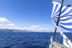Sailing ship yachts with blue white sails in the Sea. Royalty Free Stock Photo