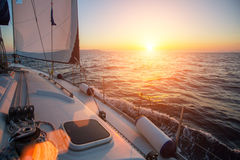 Sailing ship yachts in the open Sea during fantastic sunset. Royalty Free Stock Photography