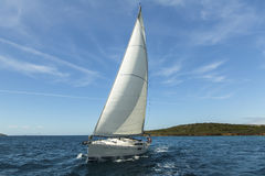 Sailing ship yachts with white sails in the Aegean Sea. Royalty Free Stock Images