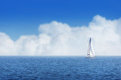 Sailing ship yachts with white sails and cloudy sky. Sailing ship yachts with white sails in morning, cloudy sky Stock Image