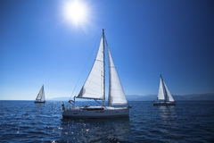 Sailing ship yachts with white sails in the open Sea. Stock Photography