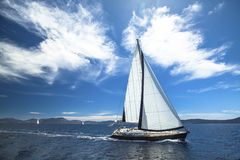 Sailing ship yachts with white sails in the open Sea. Stock Photo