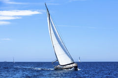 Sailing ship yachts with white sails in the open Sea. Luxury. Stock Photography