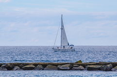 Sailing ship yachts with white sails in the open Sea. Luxury boa royalty free stock photos