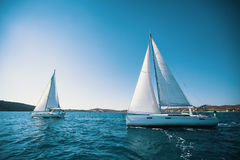 Sailing ship yachts with white sails in the sea. Luxury. royalty free stock image