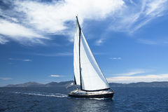 Sailing ship yachts with white sails in the Sea Stock Photo