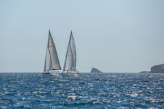 Sailing ship yachts with white sails in the Sea. Stock Image