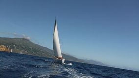 Sailing ship yachts with white sails in the Sea. Luxury boats. stock video footage
