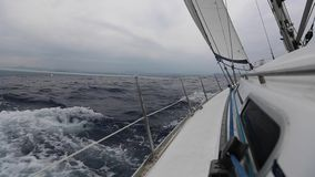 Sailing ship yachts with white sails in the sea in stormy weather. Sport. stock video