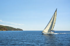 Sailing ship yachts with white sails. Shores of the Aegean Sea Royalty Free Stock Photos