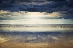 Sailing ships on Atlantic Ocean under dramatic sky. This image was taken in Hendaye, Pays Basque, France Stock Photos