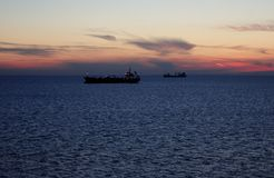 Sailing ships on the Baltic Sea. On beautiful evening sunset stock images