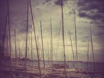 Sailing ships on the beach Stock Images