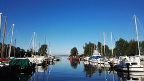Sailing ships. Beautiful harbour with sailing ships royalty free stock images