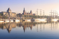 Sailing ships by Chrobry Embankment in Szczecin at sunrise. Stock Photos
