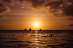 Sailingboats and couple against beautiful sunset Stock Photo