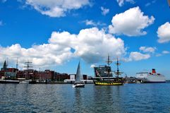 Sailing ships and cruise liner. Traditional sailing ships and a cruise liner in the harbor of Kiel, Germany stock images