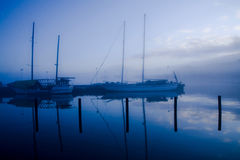 Sailing ships in harbur. Sailing ships in harbor in blue night Royalty Free Stock Photo