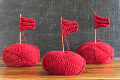 Sailing ships made from red yarn and knitting needles Stock Photos