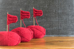 Sailing ships made from red yarn and knitting needles Stock Photography