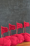 Sailing ships made from red yarn and knitting needles Royalty Free Stock Photos
